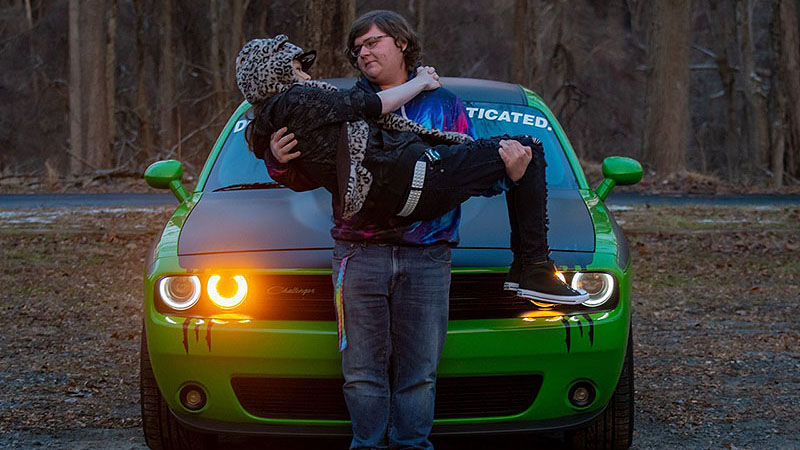 ZayhanS and his girlfriend posing in front of his 2017 Dodge Challenger T/A